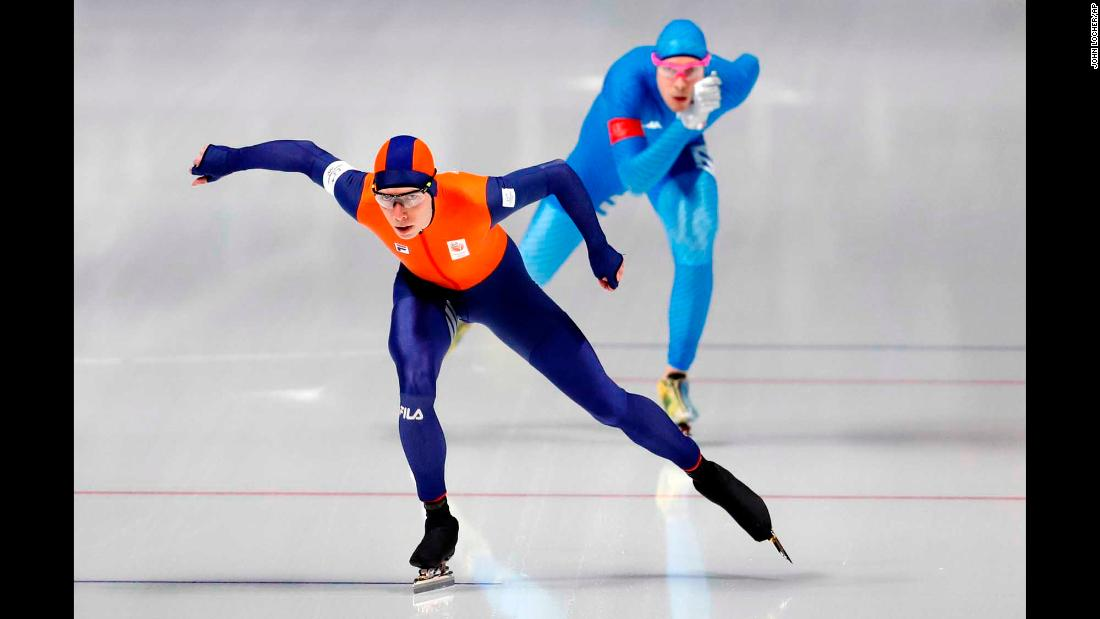 Dutch speedskater Jorrit Bergsma leads Italy's Davide Ghiotto in the 10,000 meters. Bergsma set a new Olympic record, but that was later broken by Canada's Ted-Jan Bloemen and he had to settle for the silver.