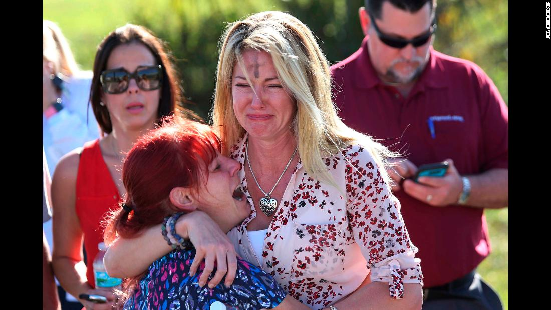 "Parents wait for news <a href=""https://www.cnn.com/2018/02/14/us/florida-high-school-shooting/index.html"" target=""_blank"">after a shooting at Marjory Stoneman Douglas High School</a> in Parkland, Florida, on Wednesday, February 14. At least 17 people were killed at the school, Broward County Sheriff Scott Israel said. The suspect, 19-year-old former student Nikolas Cruz, is in custody, the sheriff said. The sheriff said Cruz had been expelled for unspecified disciplinary reasons. <a href=""http://www.cnn.com/interactive/2018/02/us/florida-school-shooting-cnnphotos/index.html"" target=""_blank"">In pictures: Florida school shooting</a>"