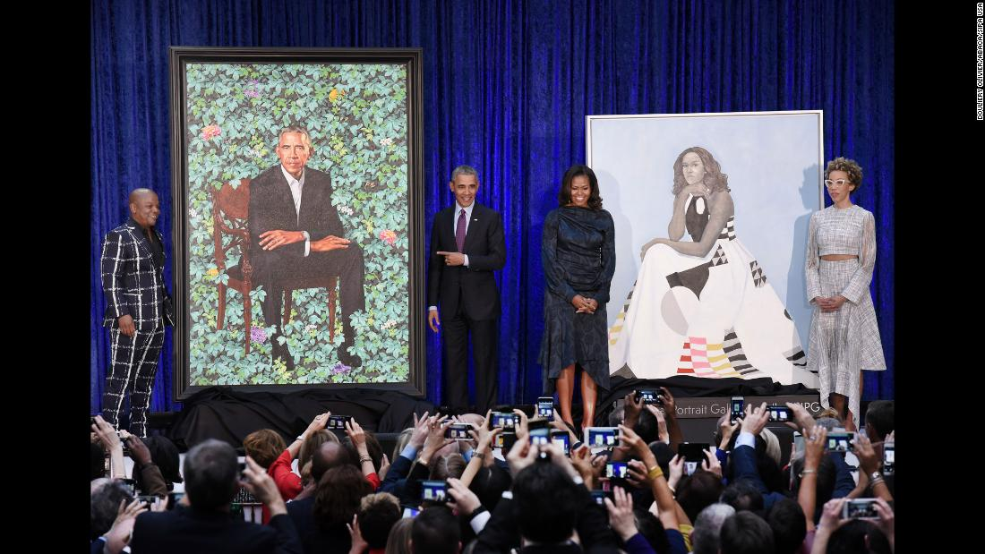 "Former first lady Michelle Obama and former President Barack Obama pose with Artists Kehinde Wiley, far left, and Amy Sherald during the <a href=""https://www.cnn.com/2018/02/12/politics/obama-portrait-unveiling/index.html"" target=""_blank"">unveiling of their official portraits</a> at the National Portrait Gallery on Monday, February 12. Obama's portrait will hang in the hall of presidents and the former first lady's will be placed in another gallery."