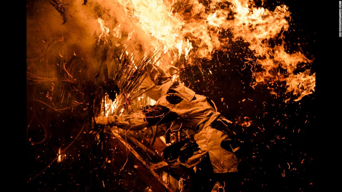 Men attempt to pull apart burning torches on Sunday, February 11, during Toba-no-Hi-matsuri, a fire festival held annually at Toba Shinmeisha, a Shinto shrine in Nishio, Japan.