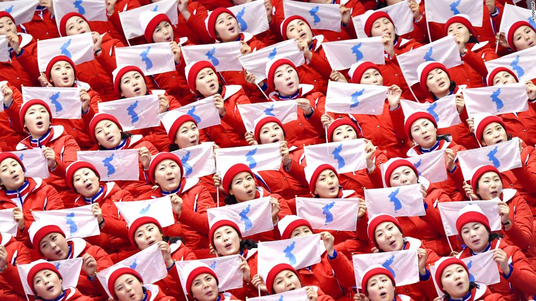 "<a href=""https://www.cnn.com/2018/02/12/sport/north-korea-cheerleaders/index.html"" target=""_blank"">North Korean cheerleaders</a> hold the Korean unification flag while singing prior to the pairs figure skating competition on Thursday, February 15 in Pyeongchang. The troupe of 230 women are in South Korea to give their vocal backing to athletes from the North who are competing over the course of the Winter Olympic Games."