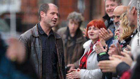 James Matthews, 43, was met by supporters as he arrived at a London court Wednesday.