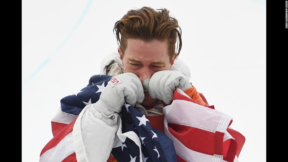 "American <a href=""https://www.cnn.com/2018/02/14/sport/shaun-white-gold-winter-olympics-snowboarding-pyeongchang-intl/index.html"" target=""_blank"">gold medalist Shaun White</a> gets emotional during the victory ceremony for the snowboard men's halfpipe final on day five of the PyeongChang 2018 Winter Olympics on Wednesday, February 14. <a href=""https://www.cnn.com/2018/02/14/sport/cnn-photos-shaun-white-gold-medal-moment/index.html"" target=""_blank"">In photos: Shaun White's gold-medal moment</a>"