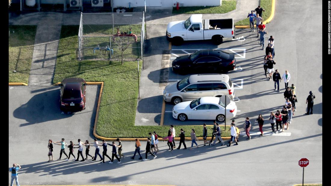 "<a href=""http://www.cnn.com/2018/02/14/us/gallery/parkland-florida-stoneman-shooting/index.html"" target=""_blank"">Students are evacuated by police</a> out of Marjory Stoneman Douglas High School in Parkland, Florida, after a shooting on Wednesday, February 14. <a href=""http://www.cnn.com/2013/07/19/us/gallery/worst-shootings-in-us/index.html"" target=""_blank"">Worst mass shootings in the United States</a>"