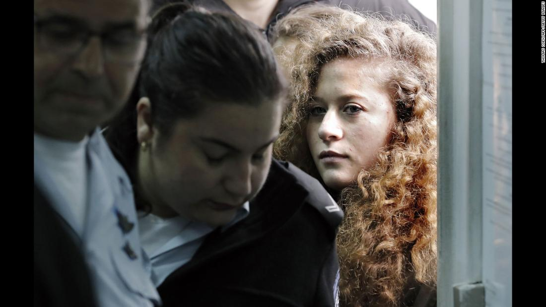 "Seventeen-year-old Palestinian Ahed Tamimi, right, a well-known campaigner against Israel's occupation, <a href=""https://www.cnn.com/2018/02/13/middleeast/ahed-tamimi-trial-intl/index.html"" target=""_blank"">arrives for the beginning of her trial</a> in the Israeli military court at Ofer military prison in the West Bank on Tuesday, February 13. Tamimi was captured on video punching and kicking an Israeli soldier in 2017."