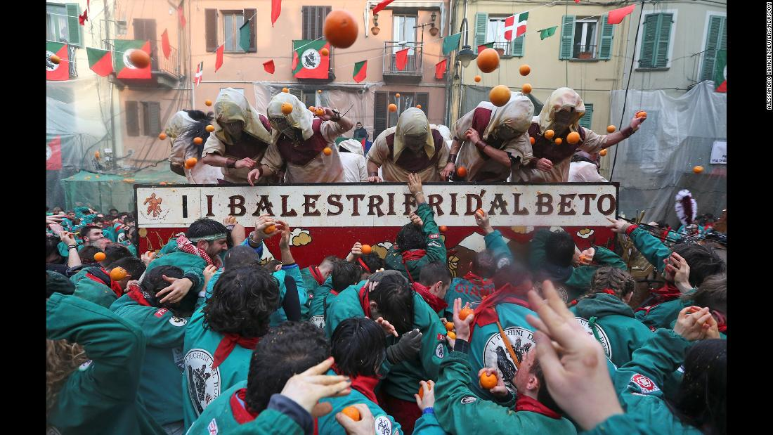 Members of rival teams fight with oranges during an annual carnival battle in the northern Italian town of Ivrea, on Sunday, February 11.