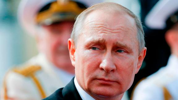 Russian President Vladimir Putin looks on as he attends a ceremony for Russia