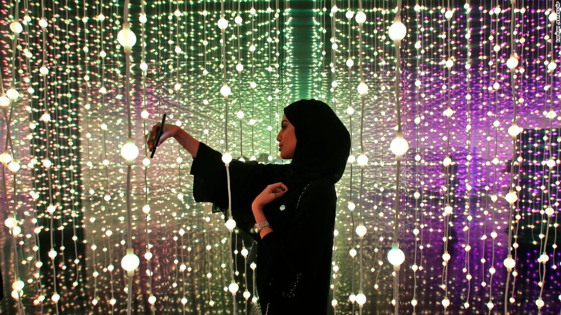A woman takes a selfie at the Edge of Government exhibition at the Museum of the Future at the World Government Summit in Dubai, United Arab Emirates, on Monday, February 12.