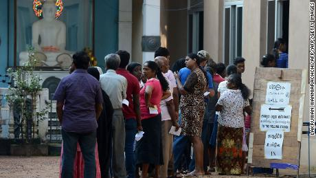 Sri Lankans queue up to cast their vote in the country's local elections at a polling station in Colombo on February 10, 2018.