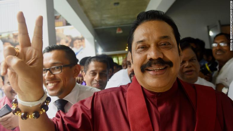 Former Sri Lankan president Mahinda Rajapakse waves to supporters at the party office following a press conference after winning the local government election in the capital Colombo on February 12, 2018.