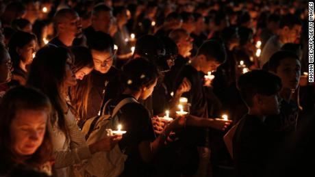 Thousands of mourners attend a candlelight vigil for victims of the Marjory Stoneman Douglas High School shooting in Parkland, Florida on February 15.