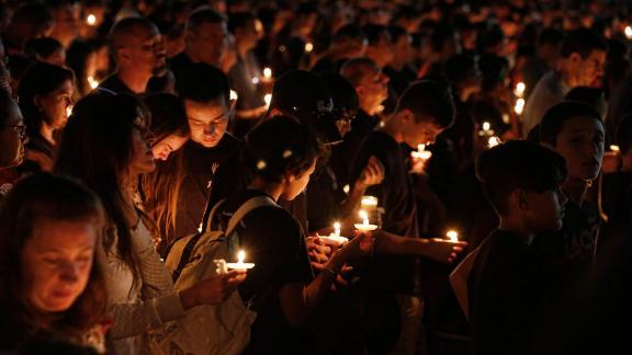 Thousands of mourners attend a candlelight vigil for victims of the Marjory Stoneman Douglas High School shooting in Parkland, Florida on February 15, 2018.