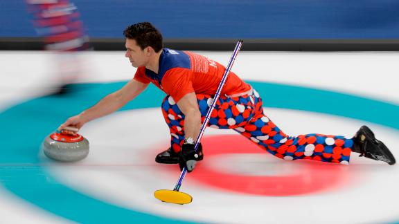 Norwegian skip Thomas Ulsrud throws a stone during a curling match against South Korea.