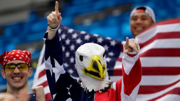 Supporters of Team USA cheer during the men's hockey game against Slovakia.