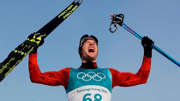 Cross-country skier DarioCologna, representing Switzerland, celebrates after winning gold in the 15-kilometer freestyle for the third straight Olympics.