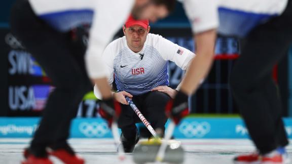 American John Shuster competes in curling.