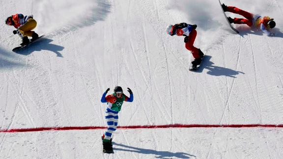 Italy's MichelaMoioli finishes first in the snowboard cross final.