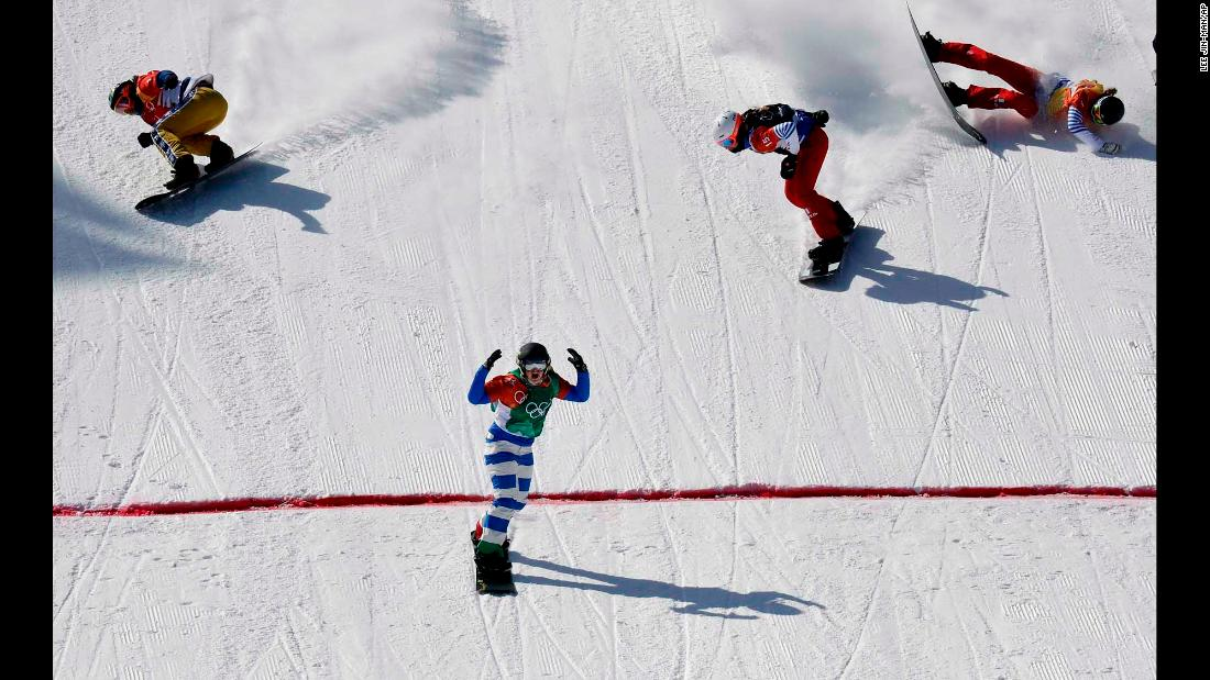 Italy's Michela Moioli finishes first in the snowboard cross final.