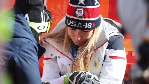 """American skier Mikaela Shiffrin is consoled after <a href=""""https://www.cnn.com/2018/02/16/sport/mikaela-shiffrin-slalom-intl/index.html"""" target=""""_blank"""">finishing fourth in the slalom</a> -- her best event and the event she won four years ago at the Olympics. She had won the giant slalom a day before."""