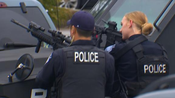 Police respond to gunfire reports Friday at Highline College in Des Moines, Washington, south of Seattle.