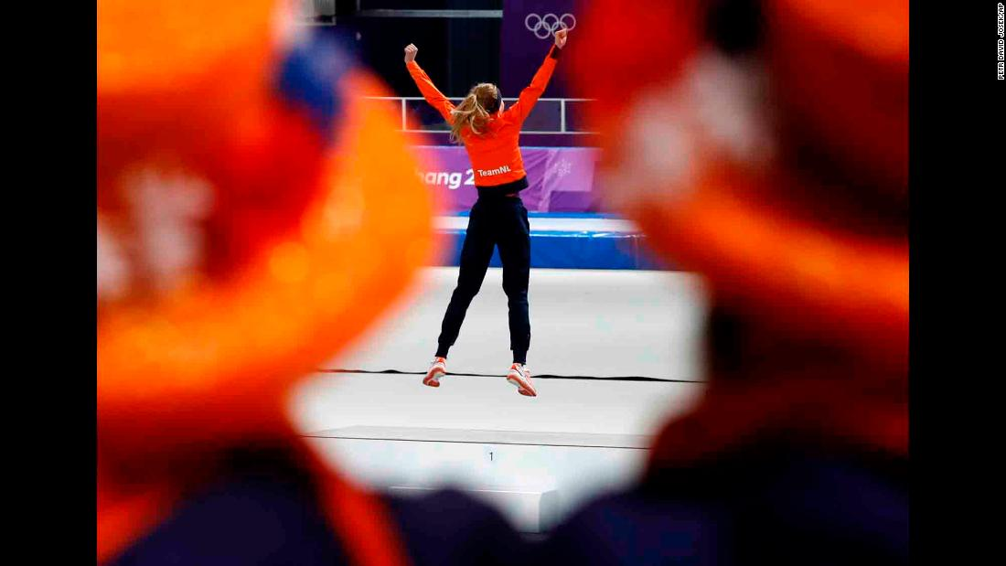 Dutch speedskater Esmee Visser celebrates on the podium after winning gold in the 5,000 meters. It is the Netherlands' sixth gold of these Games -- all in speedskating.