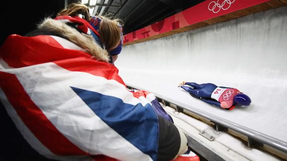 A fan watches British skeleton athlete Lizzy Yarnold.