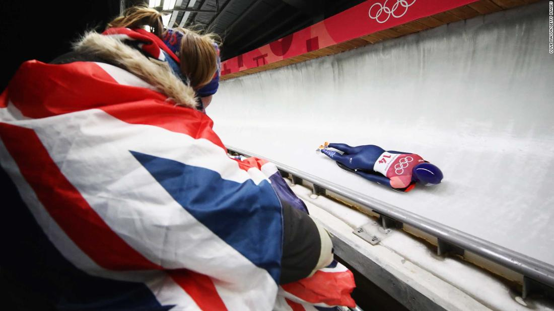 A fan watches British skeleton athlete Lizzy Yarnold.