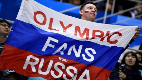 A fan attends the men's hockey game between Slovenia and the Olympic athletes from Russia.