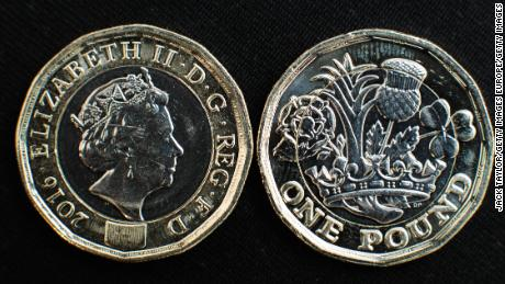 LONDON, ENGLAND - MARCH 28: In this photo Illustration, the front and back of the newly issued £1 (GBP) (one pound) coin is arranged on display on March 28, 2017 in London, England. The new £1 coin goes into circulation today and is designed to reduce the number of counterfeits in circulation with a secure 12-sided design and bi-metallic structure.  (Photo Illustration by Jack Taylor/Getty Images)