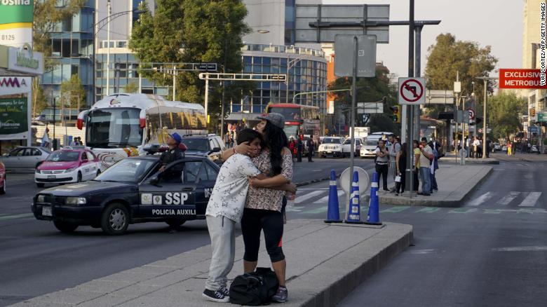 A woman embraces a boy after an earthquake shook buildings in Mexico City.