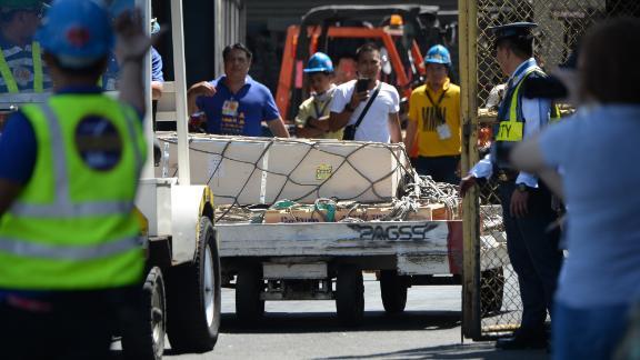 A casket containing Demafelis' body arrives last week in Manila.