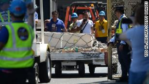 A casket containing Demafelis' body arrives last week in Manila.