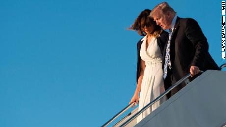 US President Donald Trump and First Lady Melania Trump arrive at Palm Beach International Airport in West Palm Beach, Florida, on February 16, 2018. / AFP PHOTO / JIM WATSON        (Photo credit should read JIM WATSON/AFP/Getty Images)