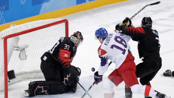 Dominik Kubalik of the Czech Republic shoots the puck against Canada's Ben Scrivens during a preliminary round hockey game.