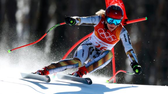 Ester Ledecka pulled off a shocking victory in the women's super-G. Ledecka, a 22-year-old from the Czech Republic, is more known for her <em>snowboarding</em> -- she was a world champion last year in the parallel giant slalom. But now she is an Olympic champion in skiing after winning the super-G by just 0.01 of a second. Next week, she will make history again as the first Olympic athlete to compete in both snowboarding and Alpine skiing.