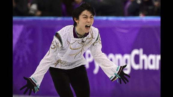 Japanese figure skater Yuzuru Hanyu performs his free skate on his way to winning the gold medal. Hanyu is the first man to repeat as Olympic champion since Dick Button in 1952.