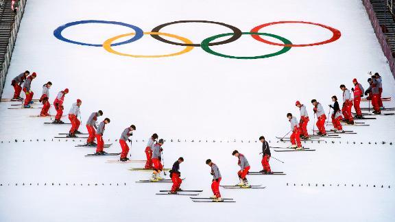 Stadium crew members prepare the snow at the Alpensia Ski Jumping Centre.