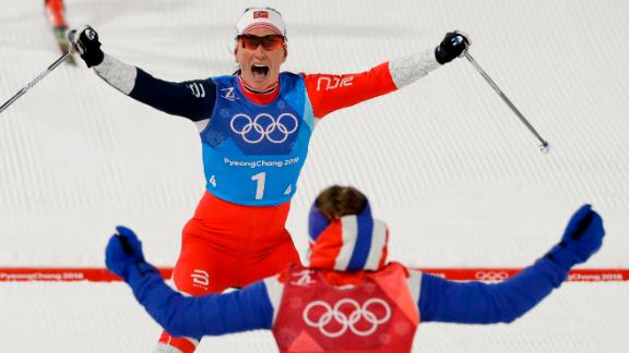 Marit Bjørgen, top, celebrates with Ingvild Flugstad Østberg after Norway won a cross-country relay. With the victory, Bjørgen became the most decorated Winter Olympian ever. She now has 13 Olympic medals, tying her with Norwegian biathlete Ole Einar Bjørndalen.