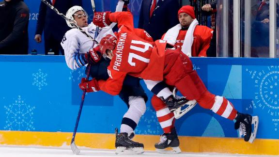 American Jordan Greenway gets checked by Russian Nikolai Prokhorkin during the preliminary round of play. The Olympic Athletes from Russia imposed their will in a 4-0 men's hockey win over the United States.