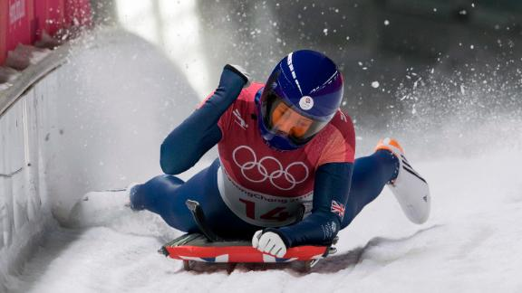 Great Britain's Lizzy Yarnold celebrates at the finish line in the women's skeleton event. She won the gold medal.