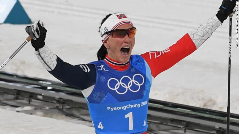 TOPSHOT - Norway's Marit Bjorgen celebrates wining the women's 4x5km classic free style cross country relay at the Alpensia cross country ski centre during the Pyeongchang 2018 Winter Olympic Games on February 17, 2018 in Pyeongchang.  / AFP PHOTO / Christof STACHE        (Photo credit should read CHRISTOF STACHE/AFP/Getty Images)