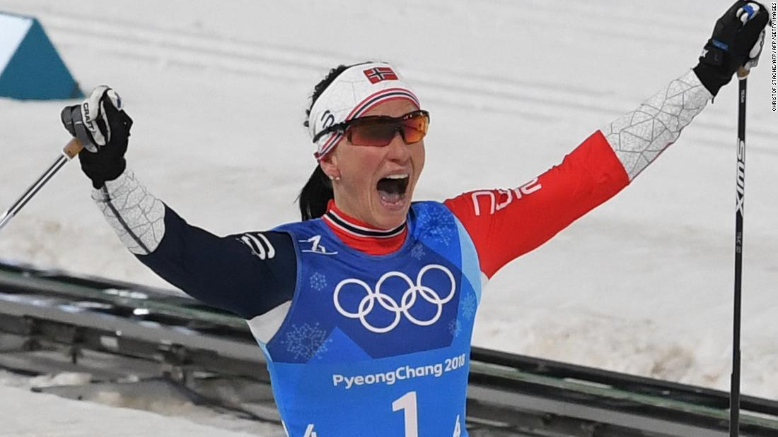 Skier matches all-time medal record with gold