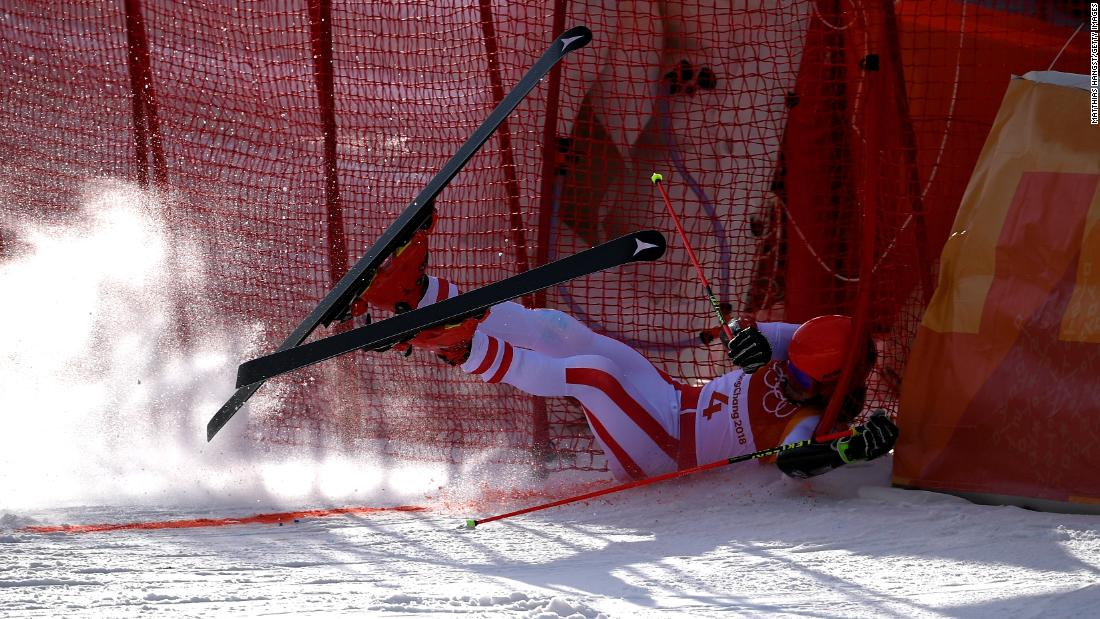 Manuel Feller of Austria crashes at the finish during the men's giant slalom in alpine skiing.