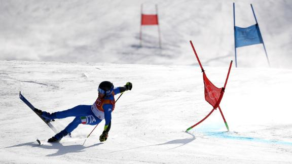 Luca De Aliprandini of Italy crashes during the men