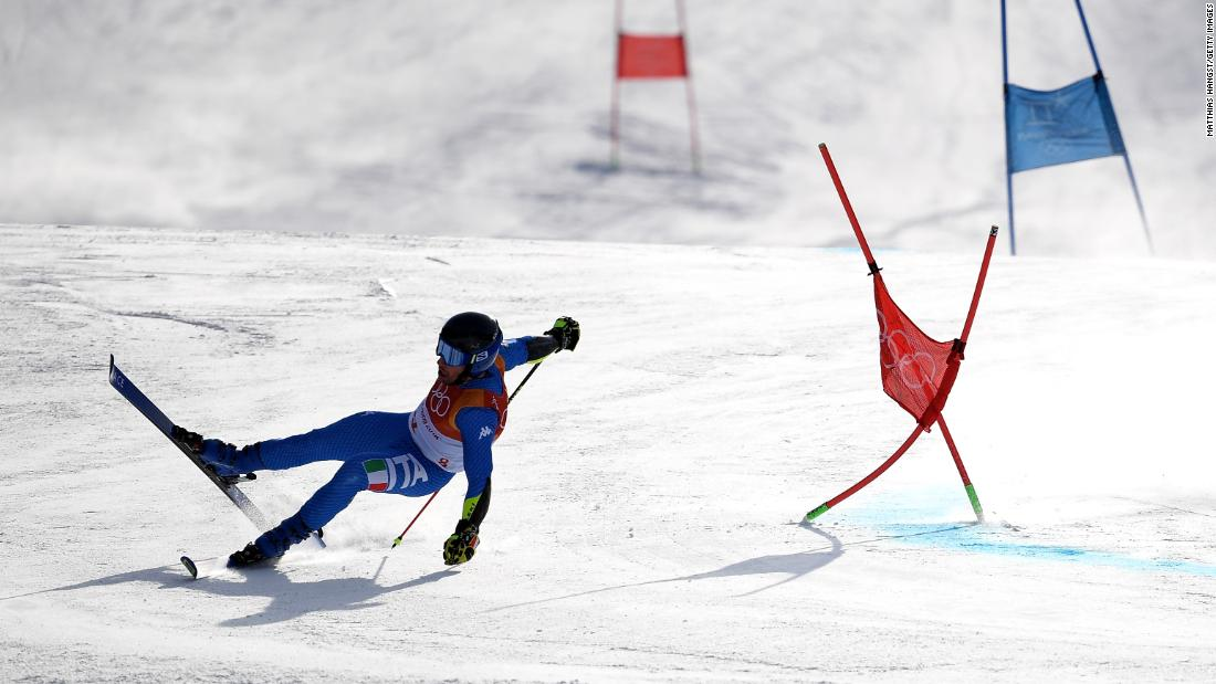 Luca De Aliprandini of Italy crashes during the men's giant slalom.