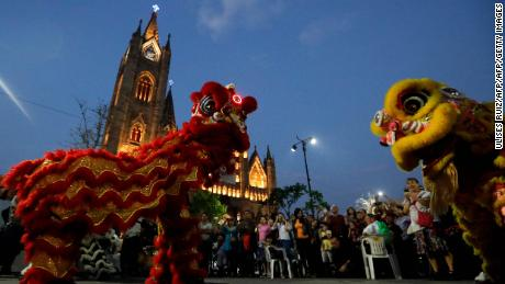 "Artists perform the ""Lion's Dance"" at Esplanade of ""Templo Expiatorio"" in Guadalajara, Jalisco state, Mexico on February 16, 2018.  Members of the Chinese community living in Mexico are preparing for the celebration of the Chinese New Year, the ""Year of the Dog"". / AFP PHOTO / ULISES RUIZULISES RUIZ/AFP/Getty Images"