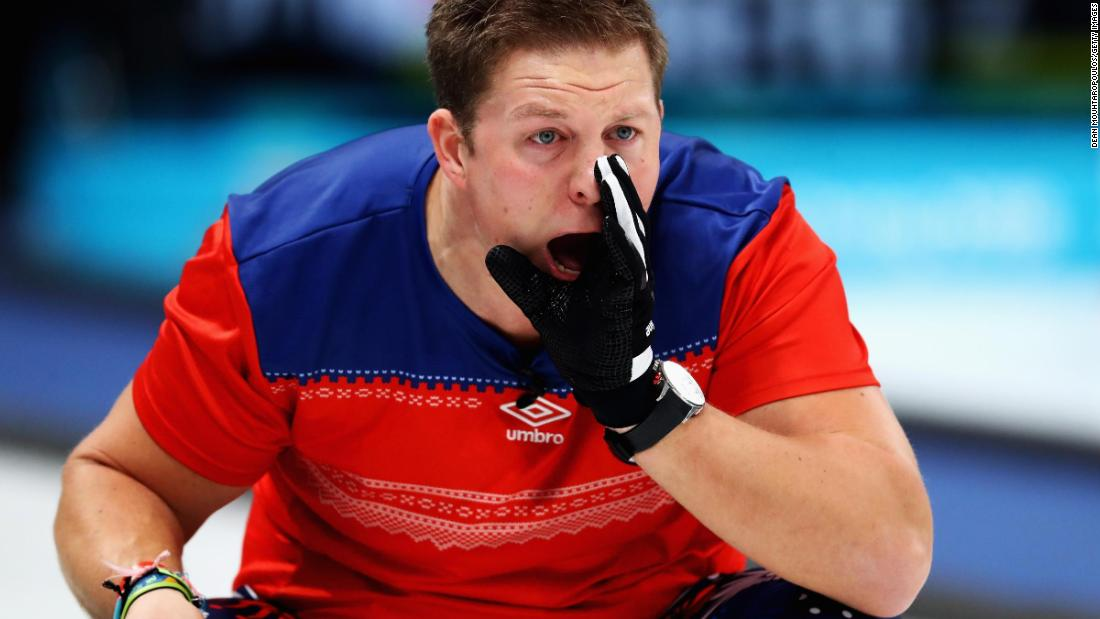 Christoffer Svae of Norway gives instructions to a team member during a curling round-robin session.