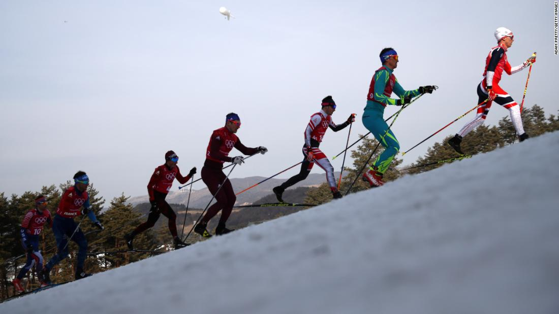 Didrik Toenseth of Norway leads in the first leg of the men's 4x10km relay in cross-country skiing.