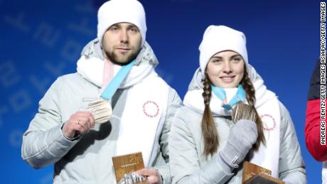 PYEONGCHANG-GUN, SOUTH KOREA - FEBRUARY 14:  Bronze medalists Aleksandr Krushelnitckii and Anastasia Bryzgalova of Olympic Athletes from Russia pose during the medal ceremony for Curling Mixed Doubles on day five of the PyeongChang 2018 Winter Olympics at Medal Plaza on February 14, 2018 in Pyeongchang-gun, South Korea.  (Photo by Andreas Rentz/Getty Images)