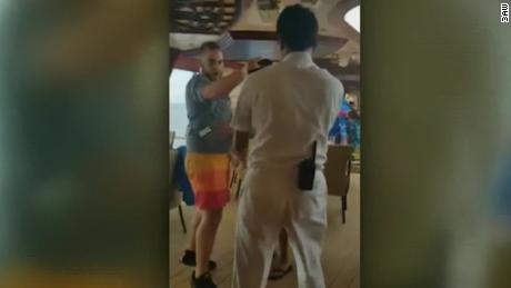 Video shows the passengers brawling with each other and being confronted by crew members.